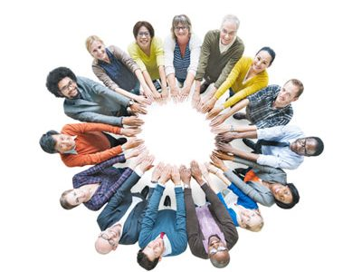 Individuals of different ethnicities bring their hands together to form a circle
