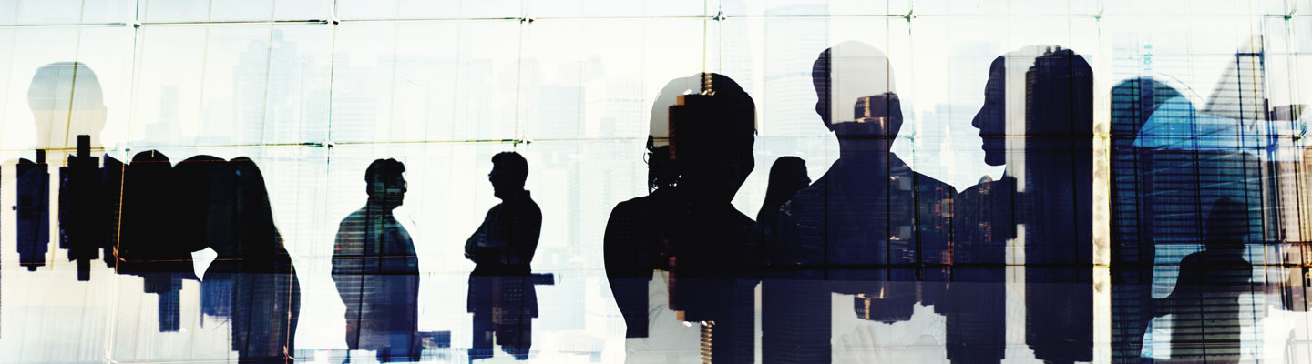 Silhouette of business people in discussion in a cityscape concept