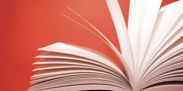 Open pages of a book against a red background