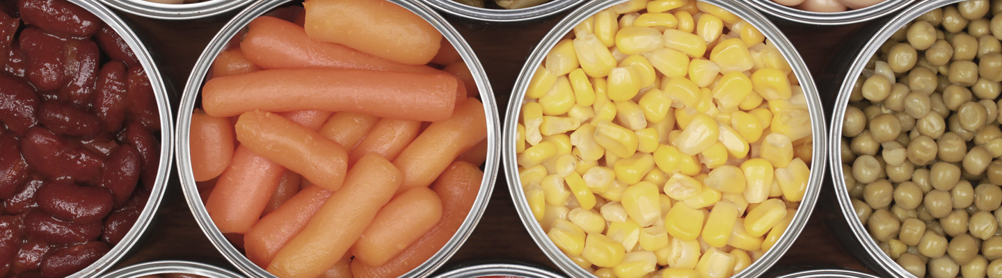 Different kinds of vegetables including corn, peas and tomatoes in cans
