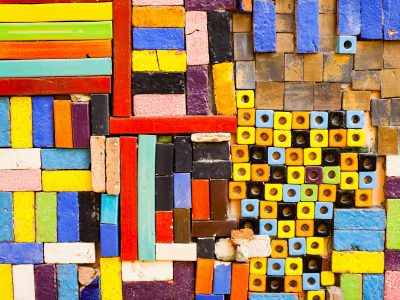 Image of multi-coloured rectangular and circular blocks stacked closely together