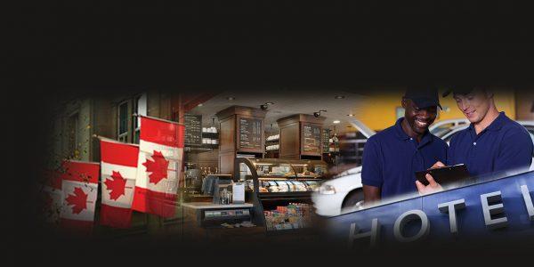 Drapeaux canadiens, comptoir d'un café, deux techniciens automobiles et enseigne d'un hôtel