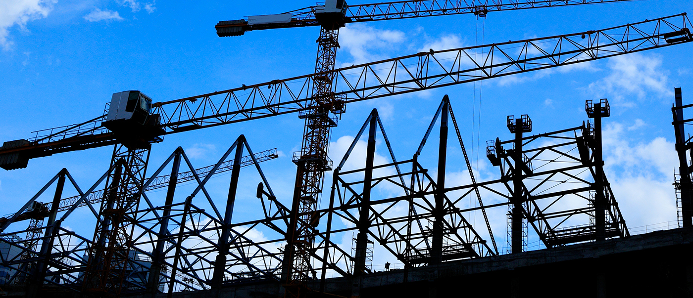 Photo of a construction site, taken from the ground and facing the sky